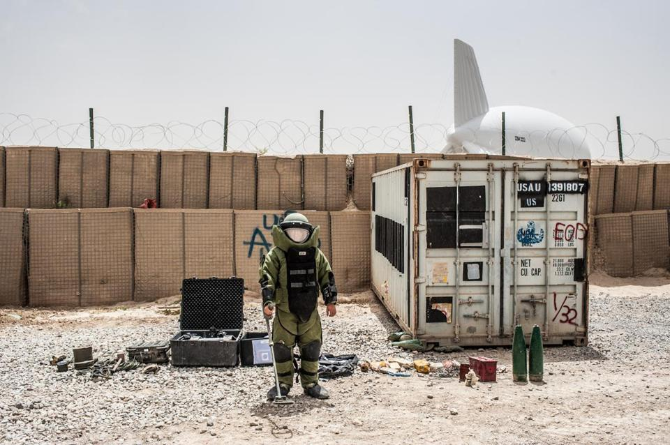 "In ""Kandahar, 2013,"" an Afghan soldier in a bomb disposal suit at Combat Outpost Ahmadkhan."